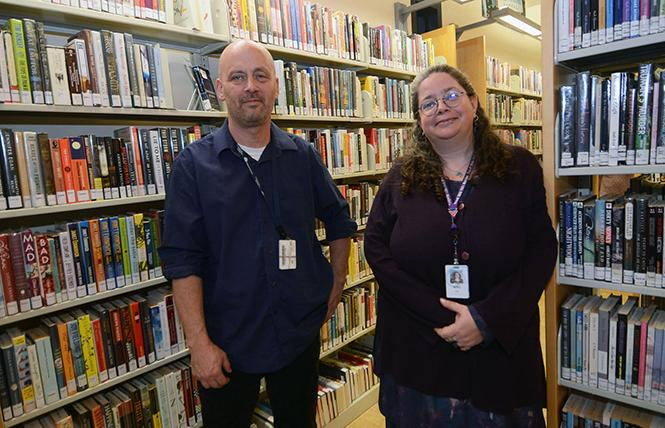 Casey Crumpacker, acting manager of the Eureka Valley/Harvey Milk Memorial Branch Library, left, and Janine deManda, adult services librarian, stand near the library books. Photo: Rick Gerharter
