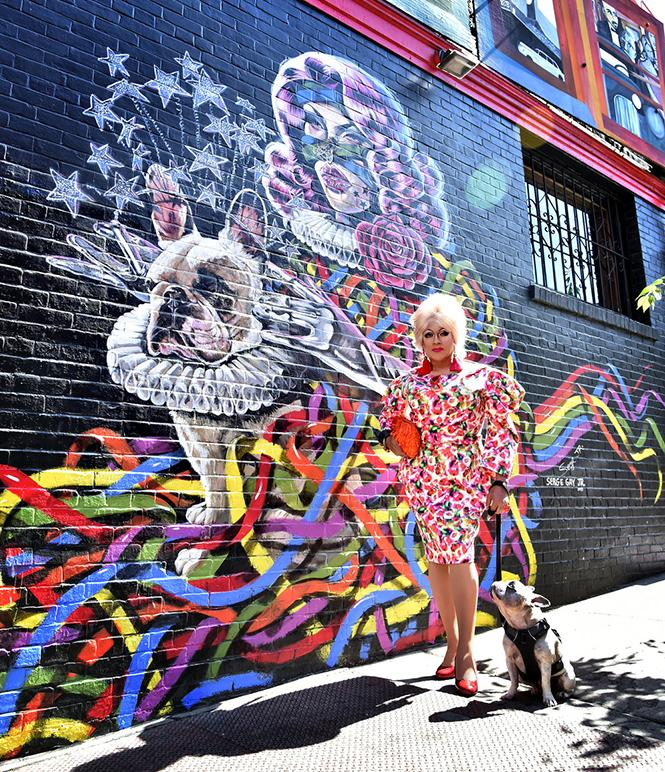 Juanita MORE! with her dog Jackson and a colorful Serge Gay, Jr. mural, one of several commissioned at venues around San Francisco. photo: Gooch