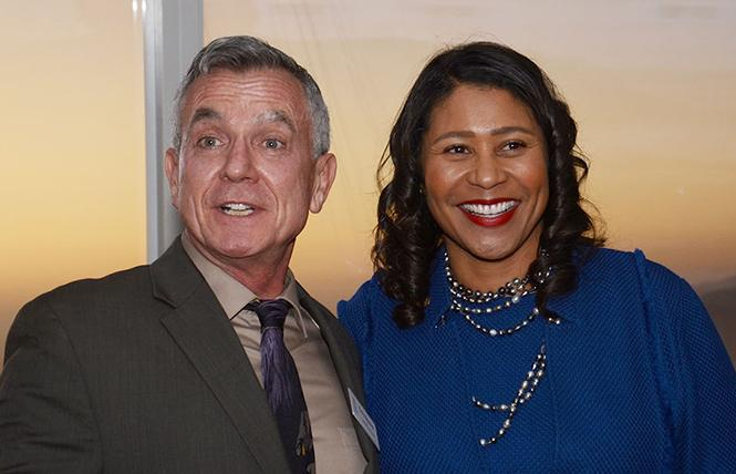 GLBT Historical Society Executive Director Terry Beswick, left, was joined by Mayor London Breed at the organization's gala atop Salesforce Tower in October. Photo: Rick Gerharter