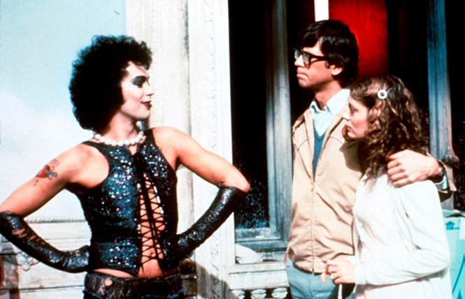 "Tim Curry as Dr. Frank N. Furter, Barry Bostwick as Brad Majors, and Susan Sarandon as Janet Weiss in ""The Rocky Horror Picture Show."" Photo: 20th Century Fox"