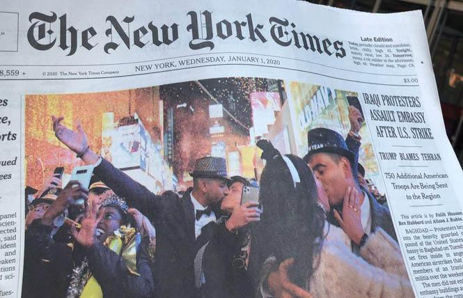 Julian Sanders holds his arm up as he kisses Jay Morales in a New Year's photo that made the front page of the January 1 New York Times. Photo: Calla Kessler/NYT via Facebook