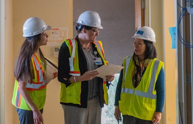 Department of Public Health officials Maricella Miranda, left; Kathy Jung; and Dr. Hali Hammer check out the work at the under-renovation Maxine Hall Health Center in the Western Addition. Photo: Jane Philomen Cleland