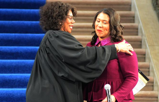 San Francisco Superior Court Judge Teri Jackson, left, embraces Mayor London Breed as she prepares to swear in the mayor to a four-year term Wednesday at City Hall. Photo: Rick Gerharter