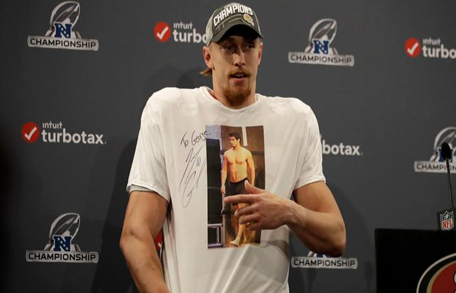 49ers tight end George Kittle wore a T-shirt featuring a shirtless image of quarterback Jimmy Garoppolo at a postgame news conference. Photo: Courtesy Screenshot