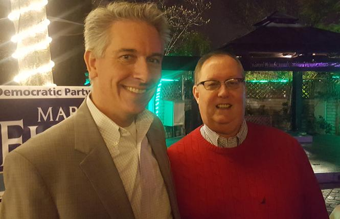 Alameda County judicial candidate Mark Fickes, left, greeted former Hayward City Council member Kevin Dowling at a campaign event at the World Famous Turf Club in Hayward. Photo: Cynthia Laird