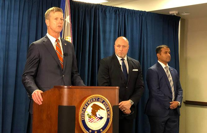 U.S. Attorney David Anderson, left, is joined by FBI Special Agent In Charge John Bennett, and Assistant Special Agent In Charge Sid Patel at the Phillip Burton Federal Building in downtown San Francisco January 28 in announcing a federal corruption charge against Public Works Director Mohammed Nuru and restaurant owner Nick James Bovis. Photo: John Ferrannini