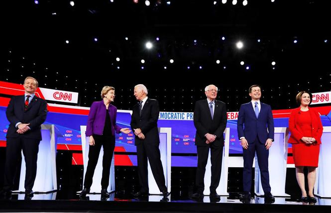 Democratic presidential candidates Tom Steyer, left, Elizabeth Warren, Joe Biden, Bernie Sanders, Pete Buttigieg, and Amy Klobuchar took the stage at a debate in Iowa earlier this month. Photo: AP