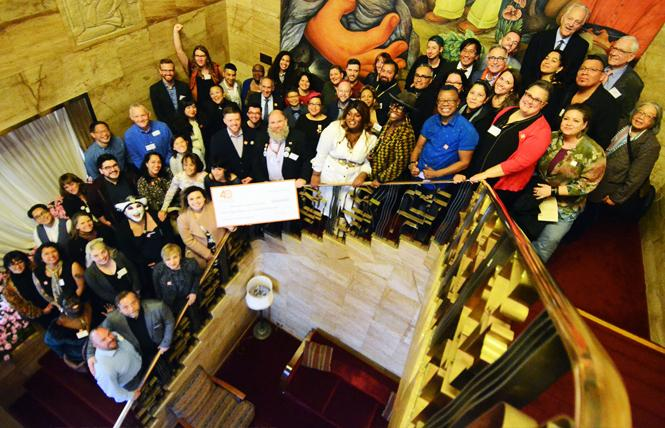 Recipients, past and present, of grants from Horizons Foundation gathered on the stairway in City Club of San Francisco for a group photo. Photo: Rick Gerharter