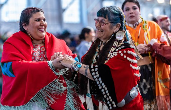Lushanya Echeverria, left, and Beverly Little Thunder took part in the round dance at the BAAITS two-spirit powwow in San Francisco. Photo: Jane Philomen Cleland