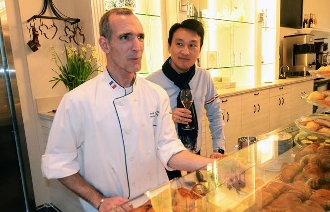Maison Danel co-owners and husbands Danel de Betelu, left, and David de Betelu stand behind the pastry counter during a February 11 media preview. Photo: Rick Gerharter