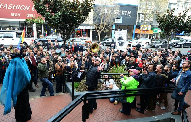 """Cleve Jones, center, remembers meeting Sylvester on his first day in San Francisco at The Haven, a gay-oriented restaurant formerly at the corner of Polk and California streets, during a """"March to Remember and Reclaim Queer Space"""" in the Polk Gulch area in March 2018. Drag queen Juanita MORE! is at left in blue veil. Photo: Rick Gerharter"""