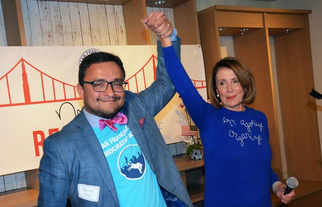 David Campos, left, chair of the San Francisco Democratic Party, and then-House Minority Leader Nancy Pelosi gave victory cheer as the Democratic Party opened its headquarters for the November 2018 midterm elections. Photo: Rick Gerharter