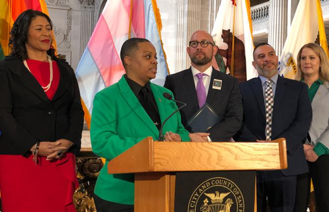 SF Pride board President Carolyn Wysinger speaks at a media event Tuesday, where she was joined by Mayor London Breed, left, Supervisor Rafael Mandelman, SF Pride Executive Director Fred Lopez, and Clair Farley, director of the Office of Transgender Initiatives. Photo: John Ferrannini