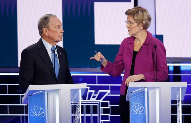 Senator Elizabeth Warren, right, makes a point to former New York City mayor Michael Bloomberg at Wednesday's Democratic presidential debate in Las Vegas. Photo: AP