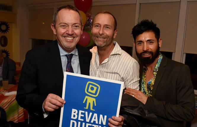BART board member Bevan Dufty, left, who's running for reelection on the progressive DCCC slate in Assembly District 17, was joined by friends Scott Hobbs, center, and his husband, Alex Serrano, at a recent birthday party fundraiser for Dufty's race. Photo: Steven Underhill