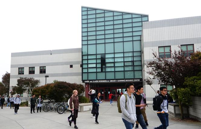 Students pass the Rosenberg Library on the main campus of City College of San Francisco. Photo: Rick Gerharter