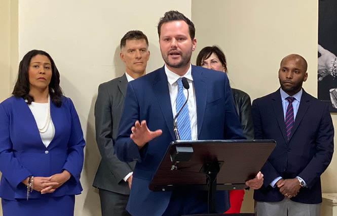 District 6 Supervisor Matt Haney, joined by Mayor London Breed, left, and Health Director Dr. Grant Colfax (behind Haney) at a Thursday news conference, discussed the city's proposed legislation to prepare for supervised injection facilities. Photo: Liz Highleyman