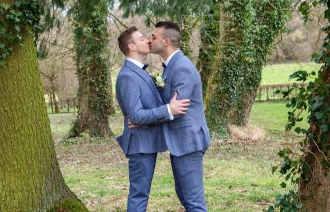 Matthew Mitcham, left, kissed his husband, Luke Rutherford, during the couple's public ceremony in Belgium. Photo: Courtesy Instagram