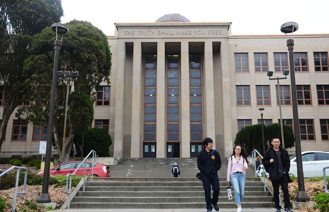 People walk past Science Hall on the main campus of City College of San Francisco. Photo: Rick Gerharter