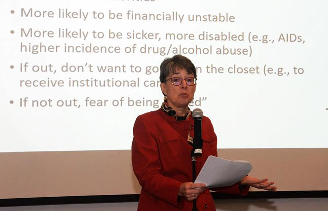Mary Twomey, the former co-director of the National Center on Elder Abuse, speaks about risk factors during a March 5 elder abuse forum at the LGBT Community Center. Photo: Rick Gerharter