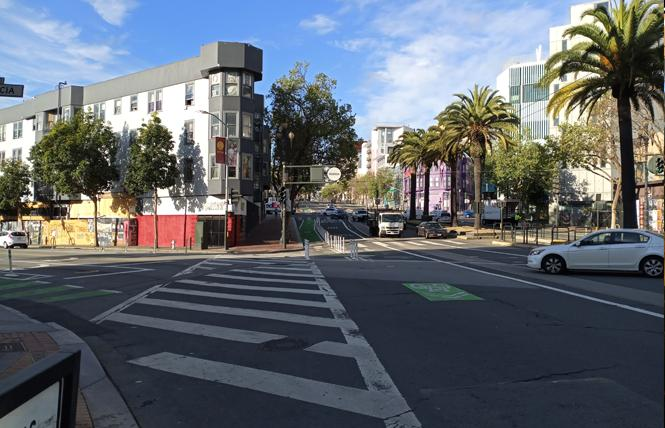 Empty streets like this at Valencia and Market were the new normal in San Francisco beginning Tuesday morning. Photo: Scott Wazlowski