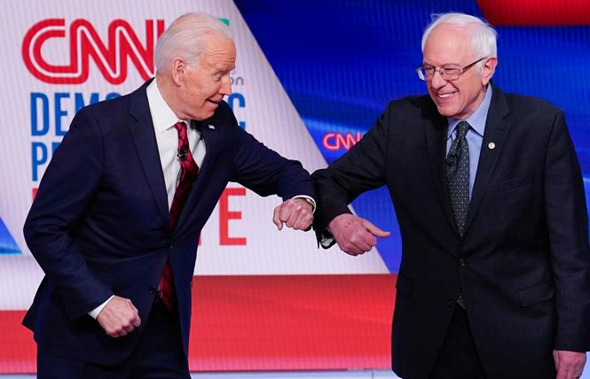 Former Vice President Joseph R. Biden Jr. and Senator Bernie Sanders of Vermont practiced social distancing by greeting each other with elbow bumps at Sunday's debate. Photo: Courtesy AP