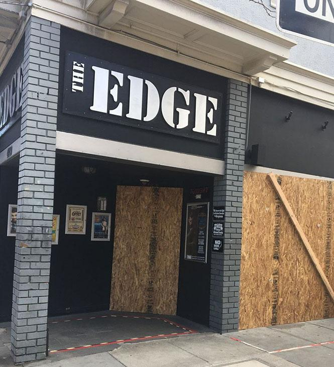 The staff of The Edge, one of all bars closed, also boarded up the bar's windows to prevent looting. photo: Mark Abramson