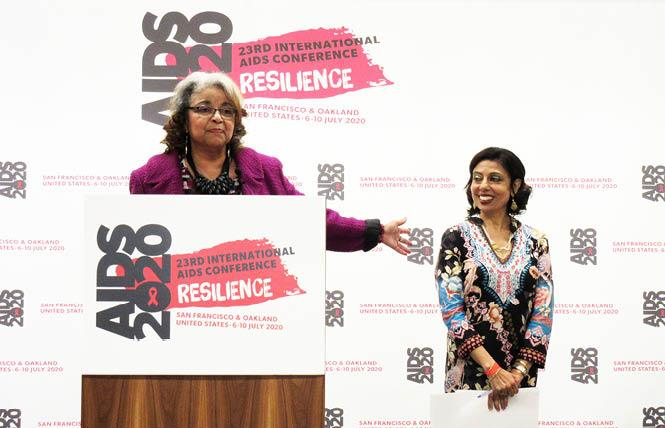 Cynthia Carey-Grant, left, gestures to her fellow AIDS 2020 co-chair, Dr. Monica Gandhi, at a conference kickoff event last fall in San Francisco. Photo: Liz Highleyman