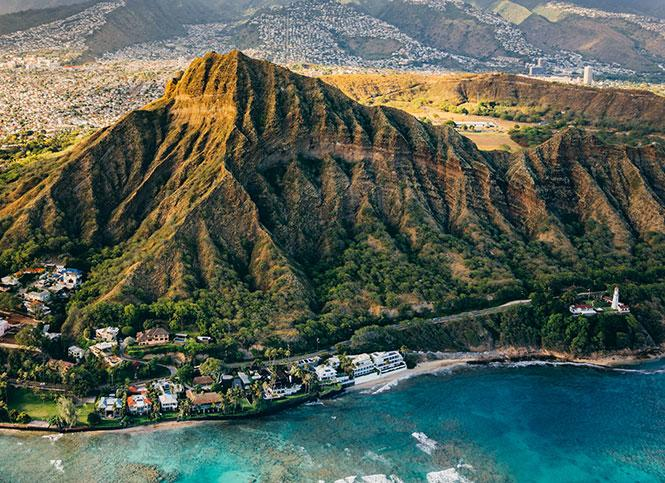 Hawaii is a popular destination, but is currently asking visitors to stay away because of the coronavirus outbreak. Photo: Diamond Head, Hawaii Tourism Authority (HTA) / Vincent Lim