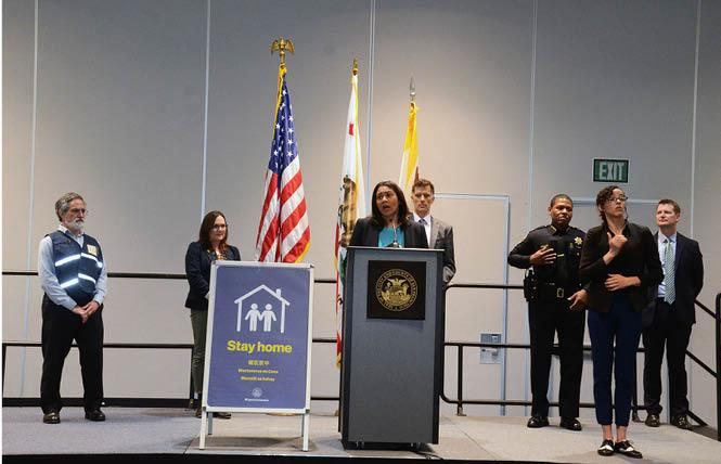 San Francisco Mayor London Breed, shown at the city's emergency operations center earlier this month, announced Monday that the shelter-in-place order would be extended through May 3. Photo: Rick Gerharter