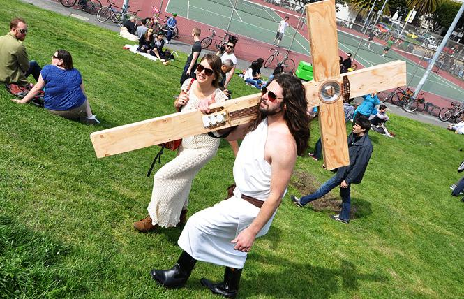 """Funky Jesus"" Sean Lavelle, right, with his custom designed wooden cross, won the 2012 Hunky Jesus contest at the annual Easter Celebration in Dolores Park hosted by the Sisters of Perpetual Indulgence. Lavelle crafted a functioning guitar onto a wooden cross, playing a few riffs in his winning bid. Photo: Rick Gerharter"