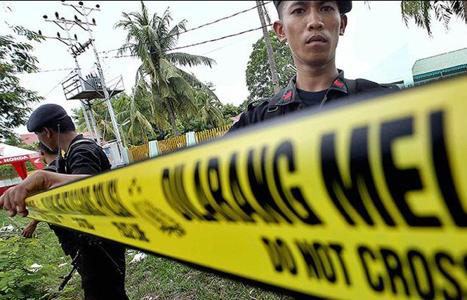 Indonesian police arrive at a crime scene. Photo: Courtesy of Shutterstock
