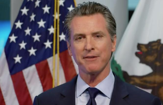 Governor Gavin Newsom speaks about benchmarks that are needed to reopen the state. Photo: Screengrab via Facebook