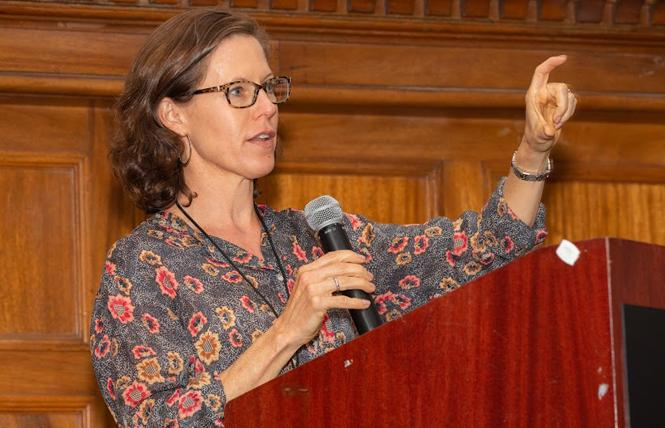 Dr. Annie Leutkemeyer, shown speaking at an End Hep C event in San Francisco last fall, cautioned against reading too much into early studies of remdesivir. Photo: Eric Slomanson/Courtesy End Hep C SF