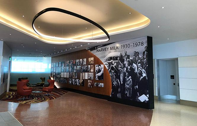 An overview of the Central Inglenook in Harvey Milk Terminal 1 at San Francisco International Airport features photos of Milk's life, and a sitting area that is frequently cleaned. Photo: Courtesy SFO