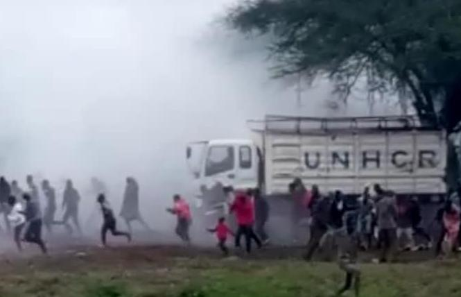 Kenyan police officers sprayed LGBT protesters with tear gas as they ran away at the United Nations High Commissioner for Refugees office in Kakuma, where the world's largest refugee camp is located. Photo: Courtesy Facebook/Sebuuma Stephen