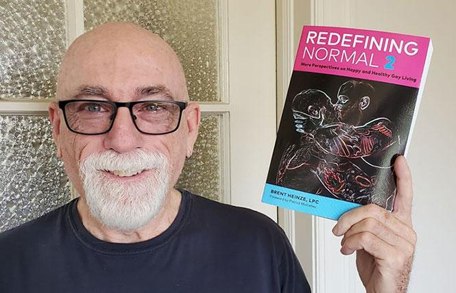 Race Bannon with his latest reading selection, Brent Heinze's 'Redefining Normal 2.' photo: Mike Pierce