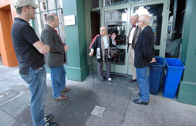 Standing in front of the site of the old Black Cat bar in San Francisco in October 2007, José Julio Sarria, center, reminisced about his time at the bar with, from left, an unidentified man, Don Berger, John Newmeyer, and then-reigning Emperor Michael Dumont. The occasion was the installation of a plaque, foreground, honoring the significance of the bar to San Francisco's LGBT history. Photo: Rick Gerharter