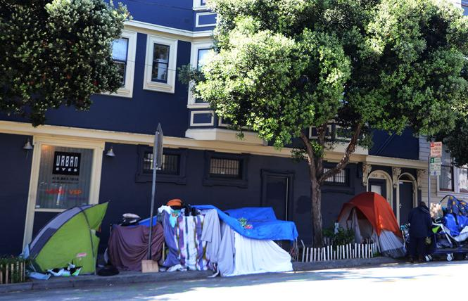 Tents have been set up on 17th Street, at Noe, in the Castro. Photo: Rick Gerharter