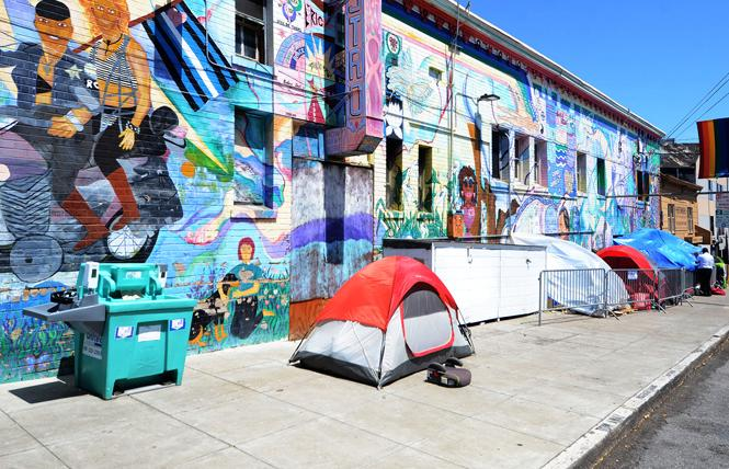 Tents and a hand-washing station sit along 16th Street near Market Street in the Castro district. Photo: Rick Gerharter