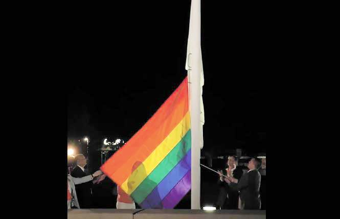 Dublin Mayor David Haubert, second from right, and City Councilman Shawn Kumagai, holding rope, raised the rainbow flag outside City Hall last year. Photo: Courtesy Facebook
