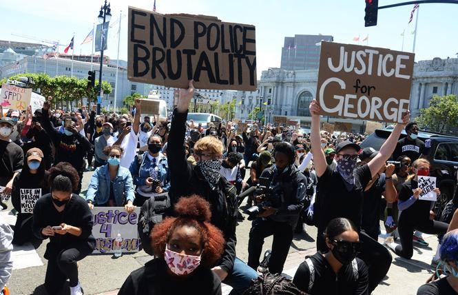 Participants at a kneel-in outside San Francisco City Hall Monday, June 1, heard from actor Jamie Foxx and Mayor London Breed as they demanded justice for the police killing of George Floyd in Minneapolis. Photo: Rick Gerharter