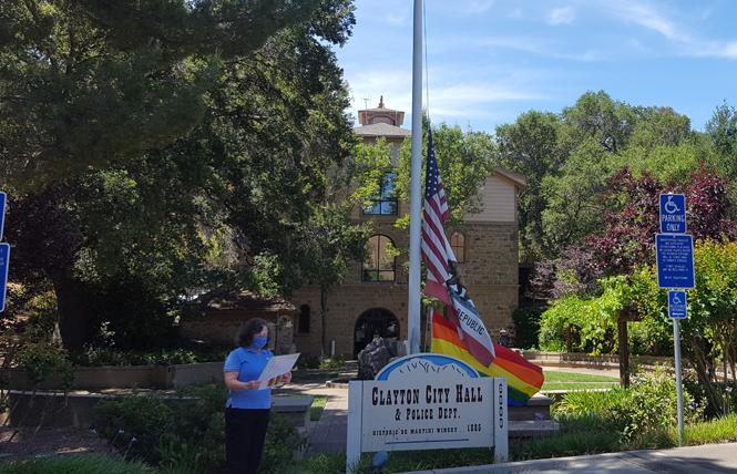 As the rainbow flag is raised at City Hall in Clayton for the first time Monday, June 1, Mayor Julie Pierce reads a proclamation declaring Pride Month. Photo: Cynthia Laird
