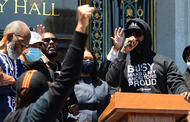 Actor Jamie Foxx speaks to several hundred people outside San Francisco City Hall Monday, June 1, who were protesting the police killing of George Floyd. Photo: Rick Gerharter