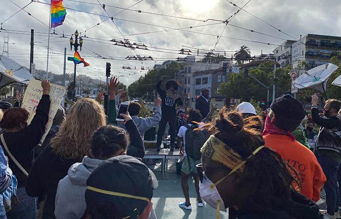 Drag performer Afrika America emceed Ready to Listen, an event in the Castro Friday, June 5, to address anti-black racism in the LGBT community. A rally in Jane Warner Plaza occurred at the conclusion of a march from San Francisco City Hall early Friday evening. Photo: John Ferrannini