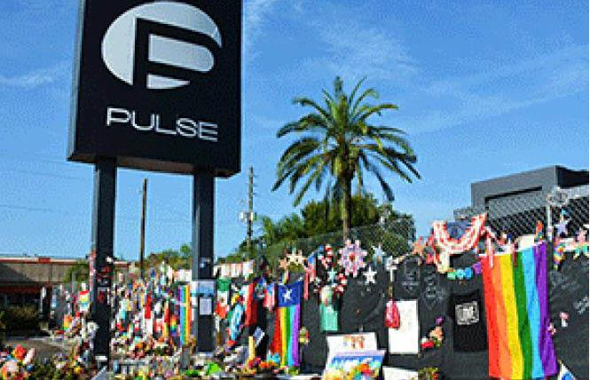 People left flowers and other items outside the Pulse nightclub in Orlando, Florida in 2016. Photo: WalterPro4755/Flickr via SFGN