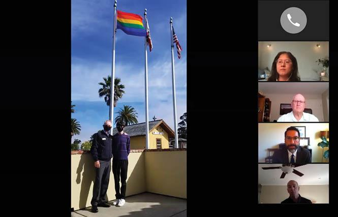 Colma Mayor John Goodwin, left, and his son, Sean, raised the rainbow flag this week at the Colma Community Center. Photo: Courtesy Town of Colma
