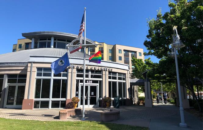 Foster City staff borrowed the rainbow flag from Island United UCC Church and raised it Tuesday in front of City Hall. Photo: Courtesy Foster City