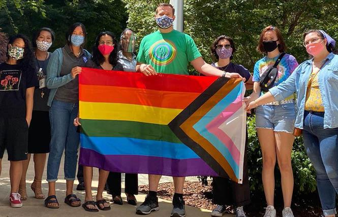 Sacramento City Councilman Steve Hansen, center, joined with LGBTQ members of his city's youth commission June 11 to raise the Progress Pride flag at City Hall. Photo: Courtesy Facebook