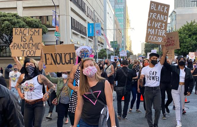 Protesters, many of whom wore masks, took part in a march for trans rights June 18. Photo: Liz Highleyman